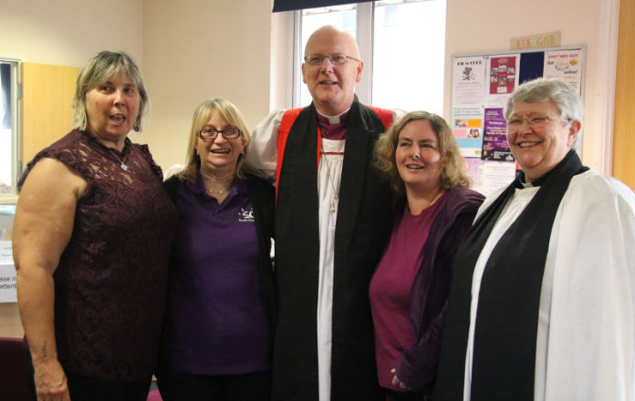 Bishop Alan with Christine Wyard (far left), two community members & the Revd Pam Wise (far right)