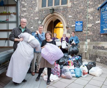 The Revd Tony Rindl with helpers outside St Mary's Church Watford