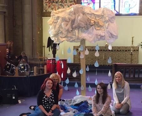 Prayers on raindrops hanging from art installation at St Cuthbert's, Hoddesdon