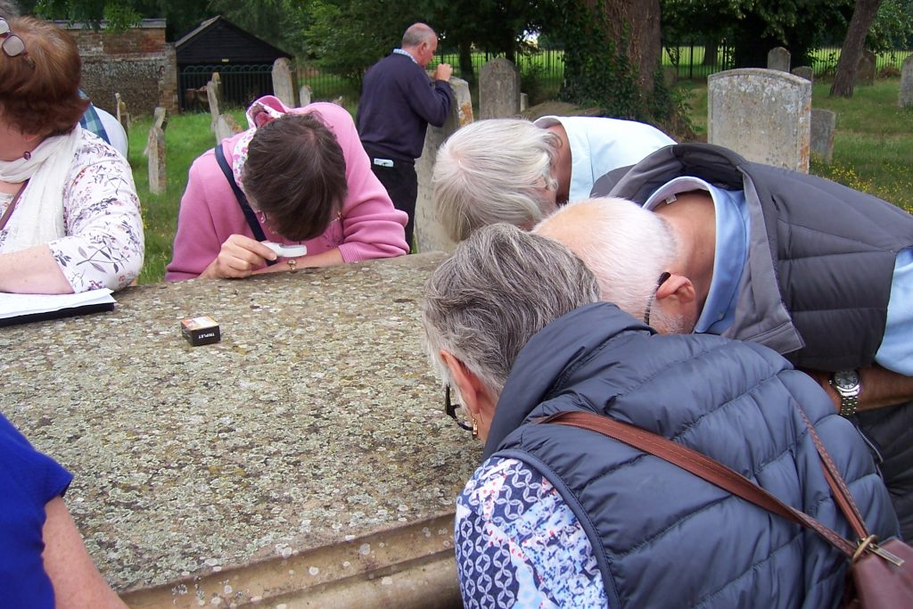 Living Churchyard Day at Potton - examining Lichen