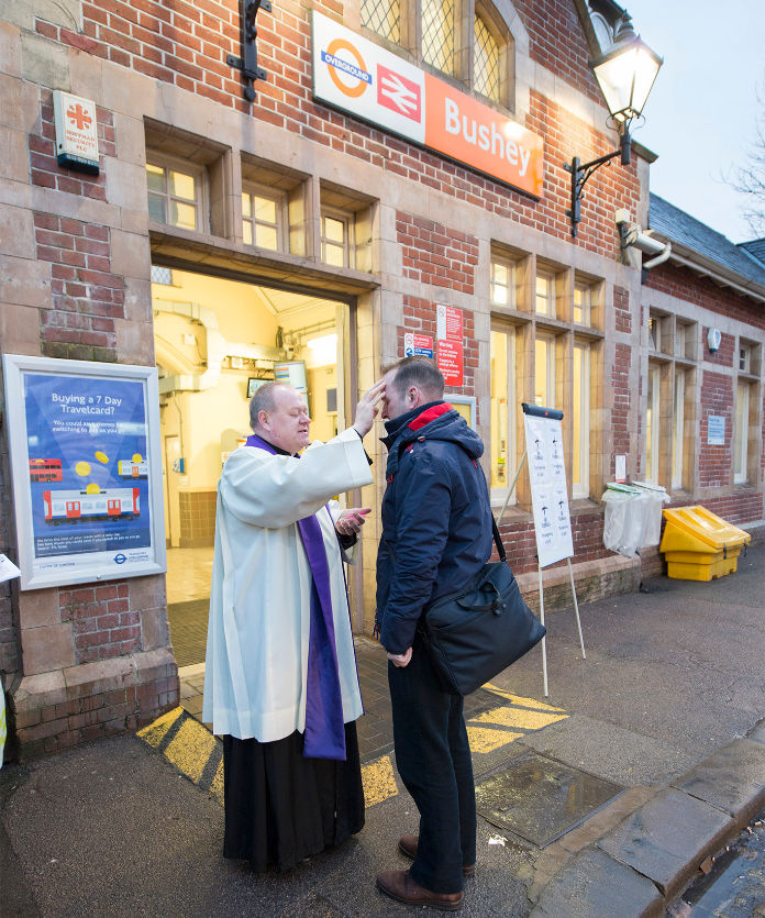 Fr Neil Kelley, Rector of Bushey, with a commuter