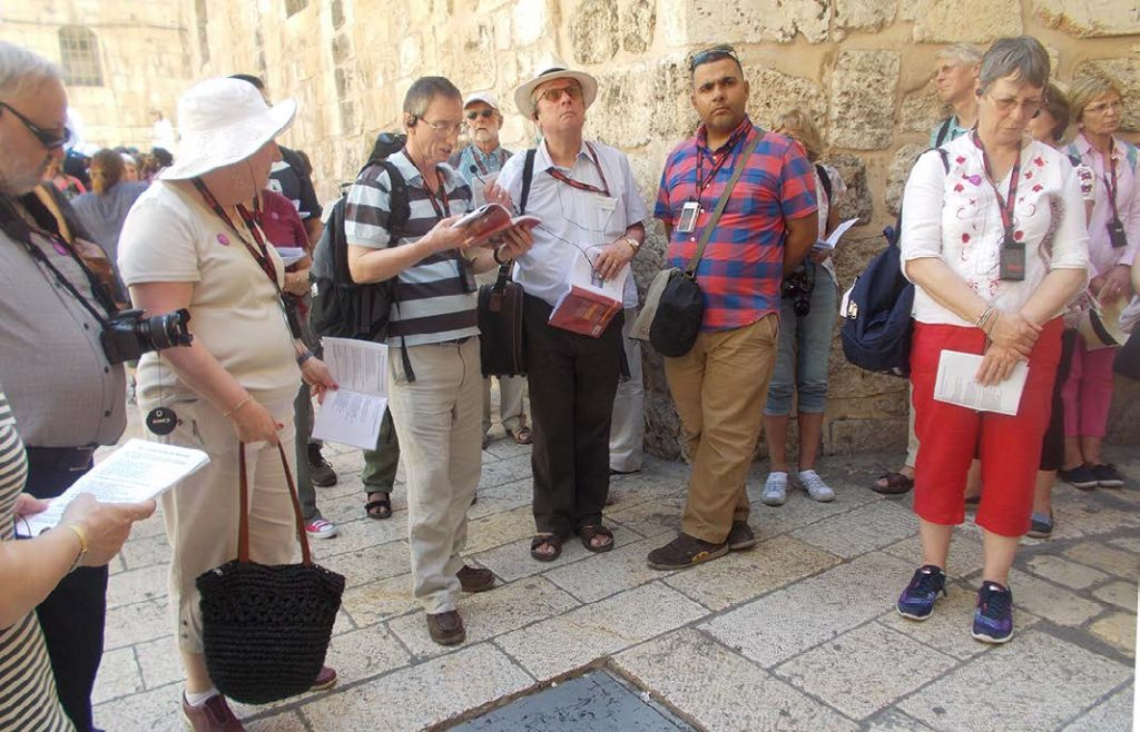 The Revd Peter Crumpler with others on the Via Dolorosa in Jerusalem