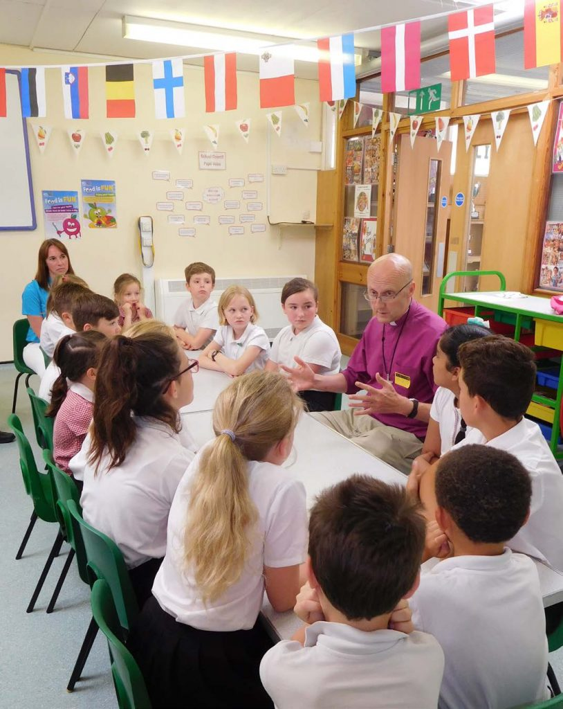 Bishop Michael talking to pupils