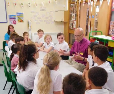 Bishop Michael talking to pupils