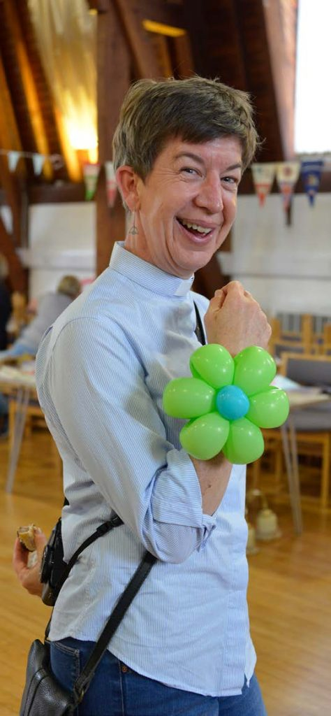 The Revd Kylie Hodgins shows off her freshly made balloon corsage