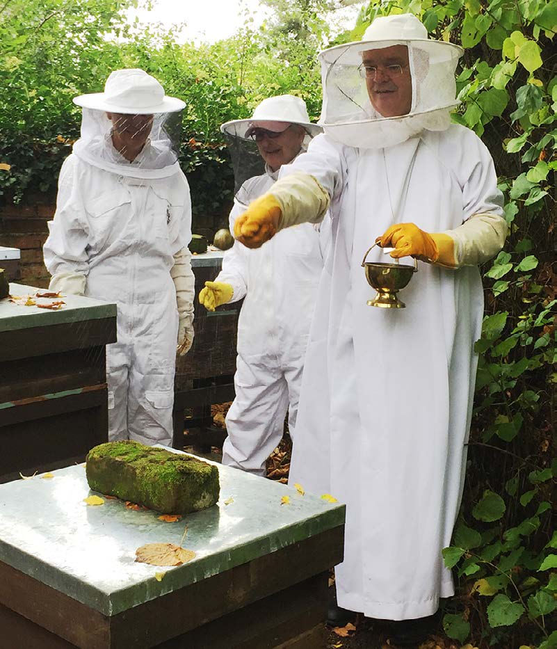 Bishop Richard blessing the bees at All Saints
