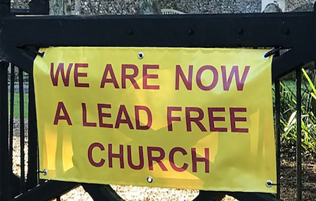"Banner: ""We are now a lead free church"""