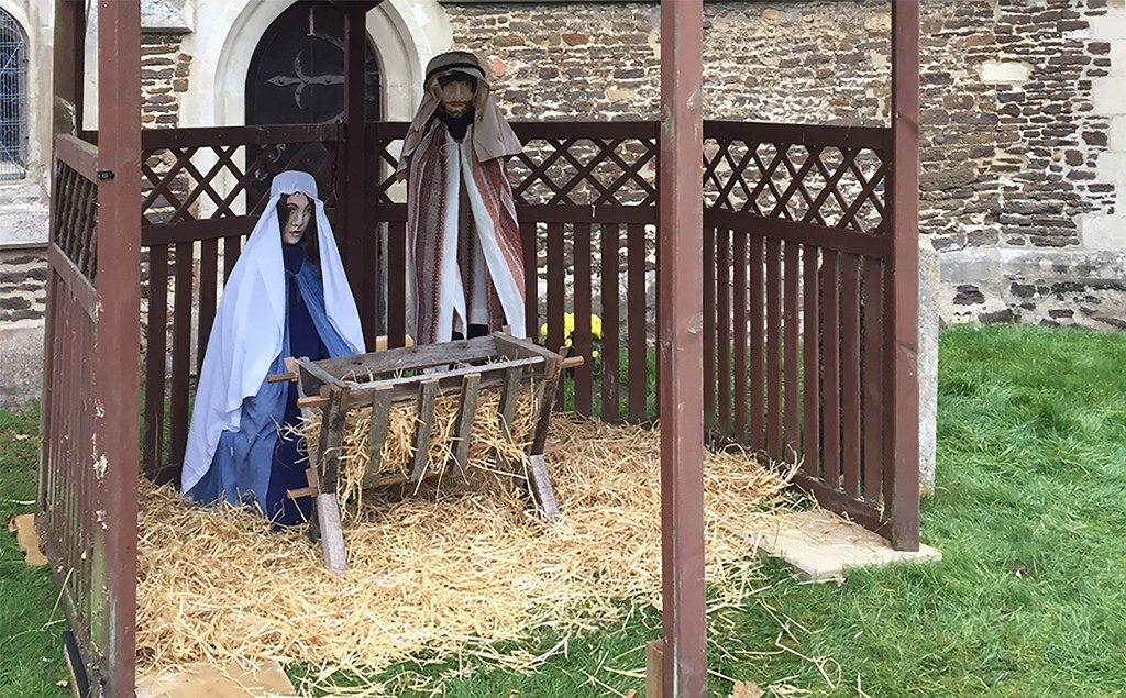 Life-size wooden nativity outside All Saints Clifton