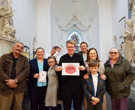 The Revd Terrance Bell with parishioners and participants