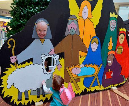 Bishop Richard in a nativity scene cut-out